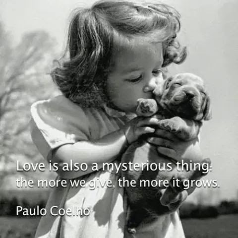 """Love is also a mysterious thing: the more we give, the more it grows."" ~ Paulo Coelho; Picture of a little girl kissing a puppy."