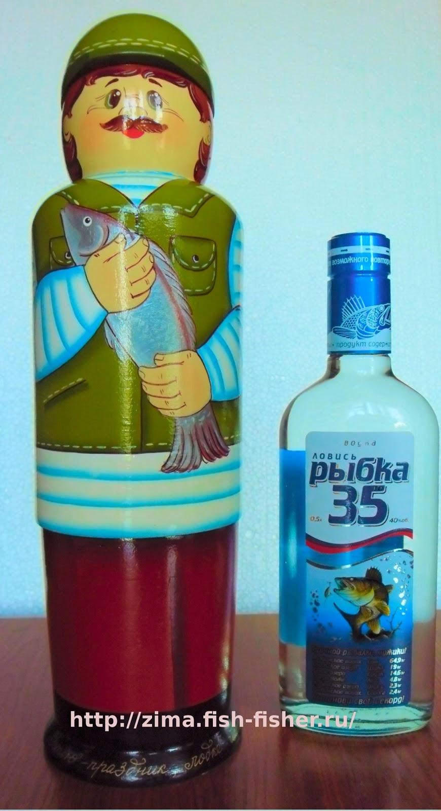 Отличный подарок рыбаку — деревянный футляр для бутылки водки. Он может стать украшением стола