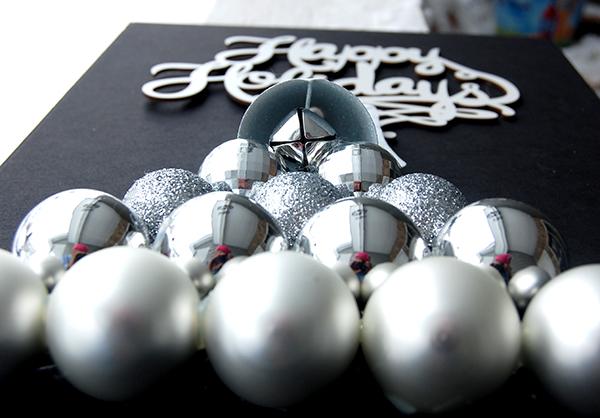 White Happy Holidays sign, white glitter ornament, silver ornament bulbls
