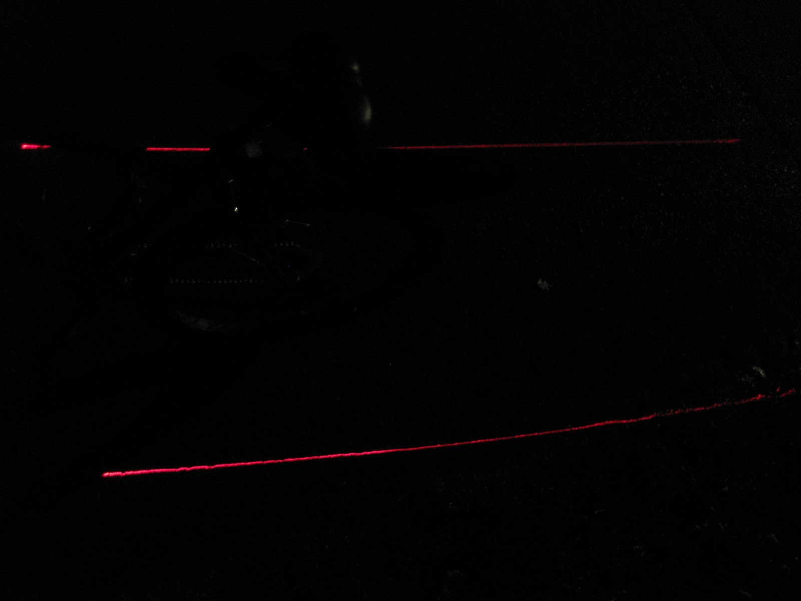 My bicycle rear red light projects these laser lines.