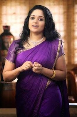 Malayalam actress Kavya Madhavan in Violet Sari