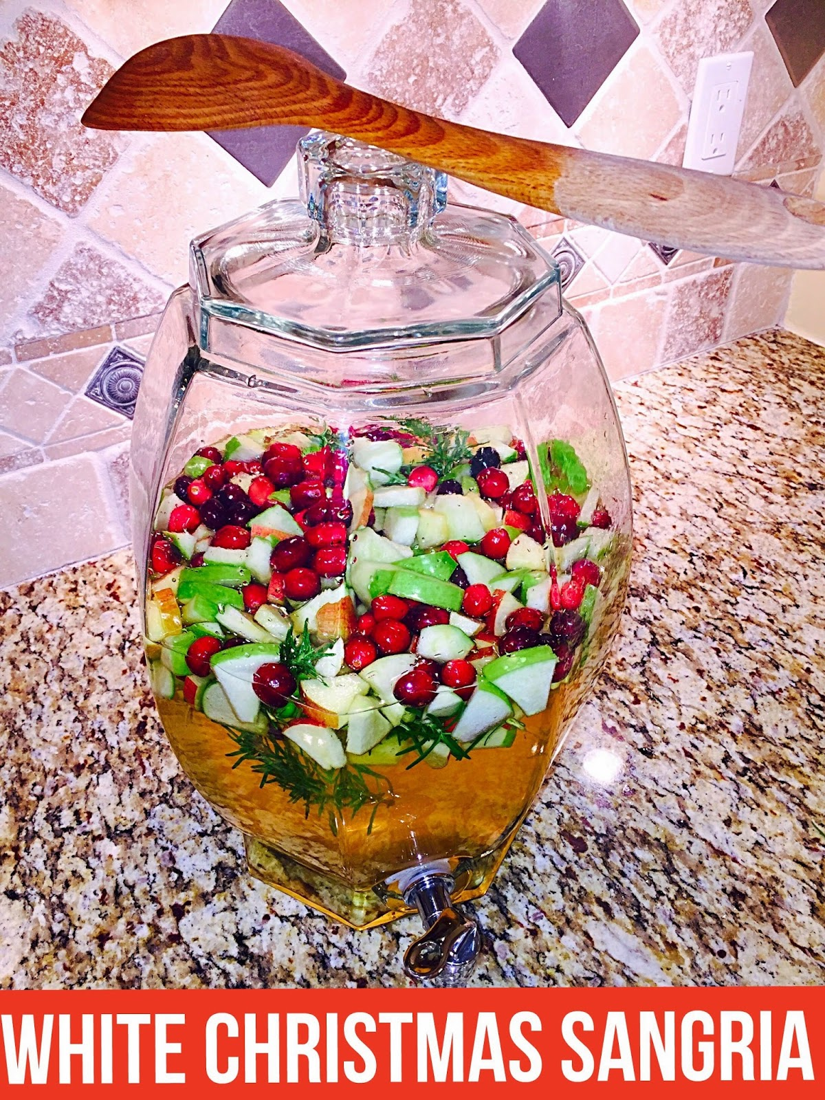 after i had added all the fruit and sugar i poured in the whole box of chardonnay and dropped in the sprigs of rosemary now that everything was in there