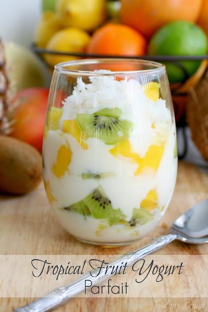 Tropical Fruit Yogurt Parfait - yummy pineapple, mango, and kiwi layered with vanilla yogurt and topped with sweetened coconut | jordansonion.com