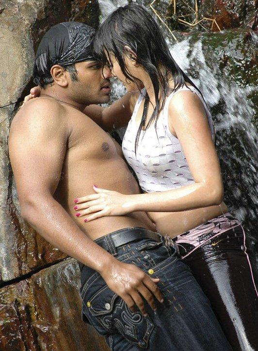 Sneha Ullal Hot Fountain Bathing Phots