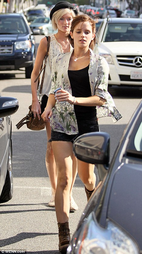 emma watson photos showed off her legs in a pair of very