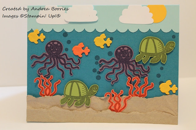 Card that looks like an under the sea scene. Stamped and cut-out seaweed, turtles and octopi along with fish brads.
