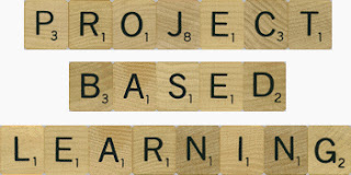 Scrabble pieces spelling our project based learning