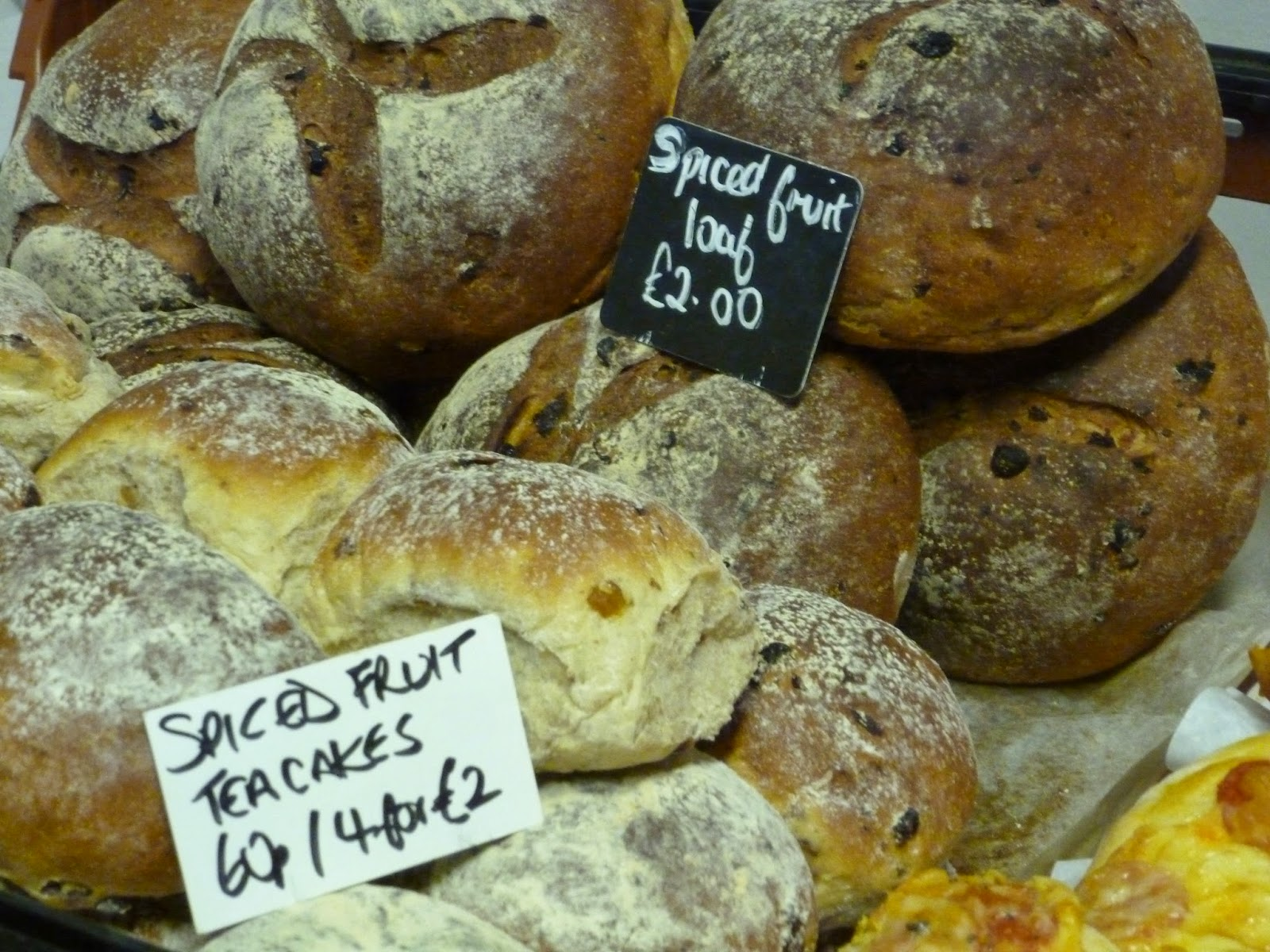 Farmers market stall fresh bread spiced fruit loaf and spiced fruit teacakes