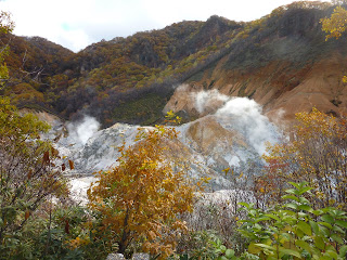 Jigokudani (Hell Valley) at noboribetsu onsen taken from a viewing area with some steam indicating it's geothermal activity