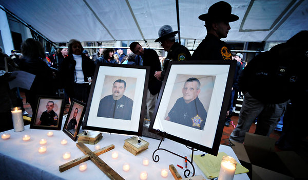 Photo: A vigil for four police officers from Buchanan County, Va., ...