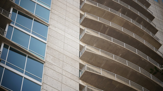 picture of a balconies of a glass building