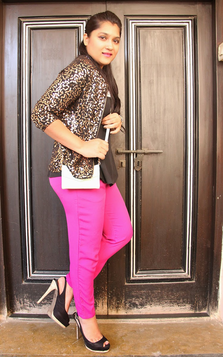 Sequinned jacket with bright trousers