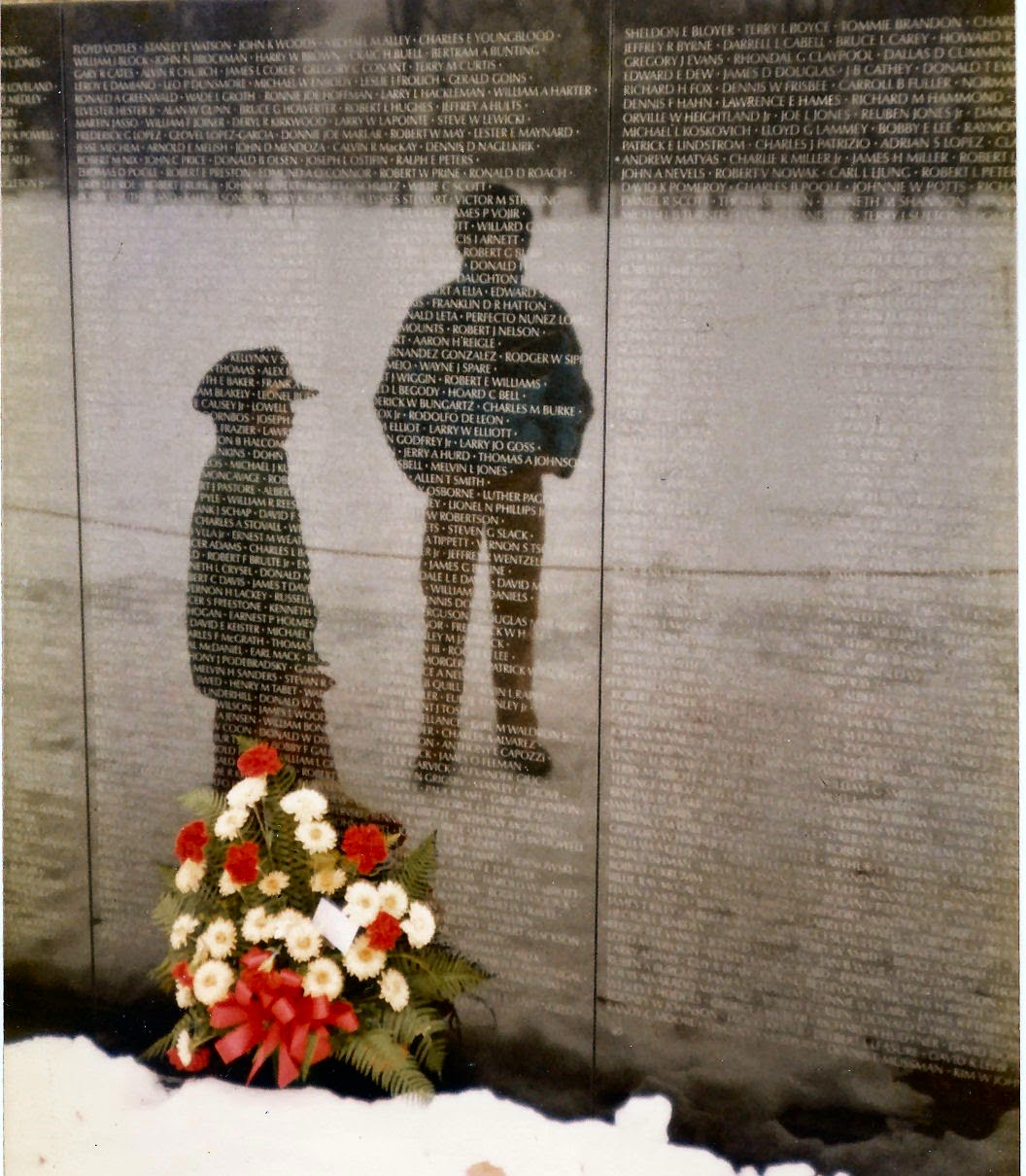 boys reflected in the Vietnam Memorial