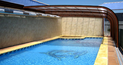 Cubiertas telesc picas para piscinas y cerramientos en - Piscina villaviciosa de odon ...