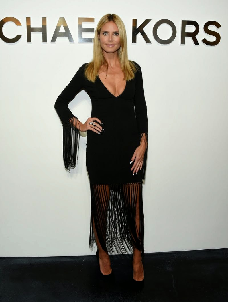 Heidi Klum wears a low-cut fringed dress to the Michael Kors Spring 2015 New York Fashion Week Show