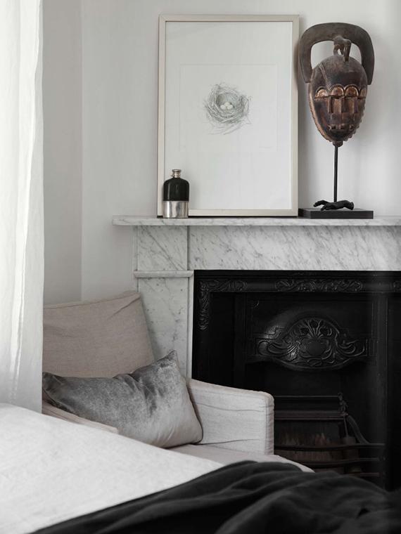 Marble fireplace via Est Magazine