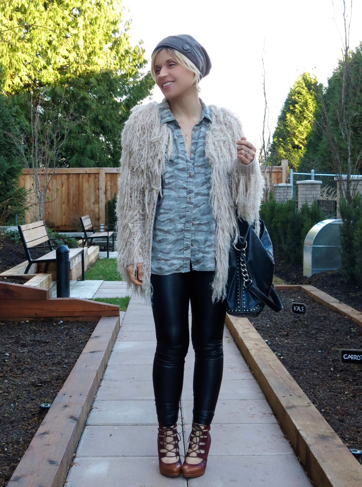 styling a shaggy cardigan with a camo shirt, leather beanie and leggings, and lace-up heels