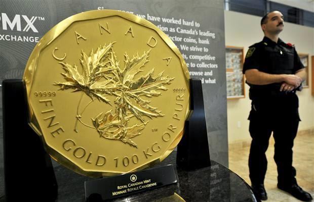 Золото в слитках и монетах