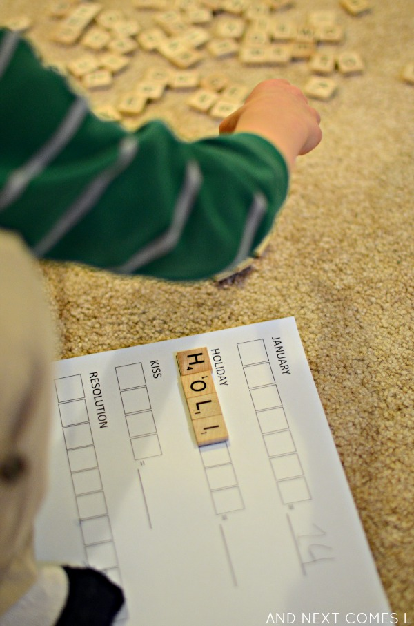 Using Scrabble tiles to spell New Year's vocabulary and practice elementary math - comes with free printable from And Next Comes L