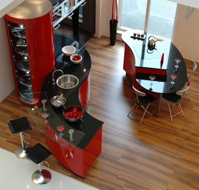 modern kitchen design in red and black with curved shapes