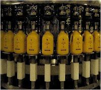 filling aloe vera gel to bottle