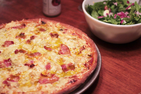 homemade baked pizza and salad