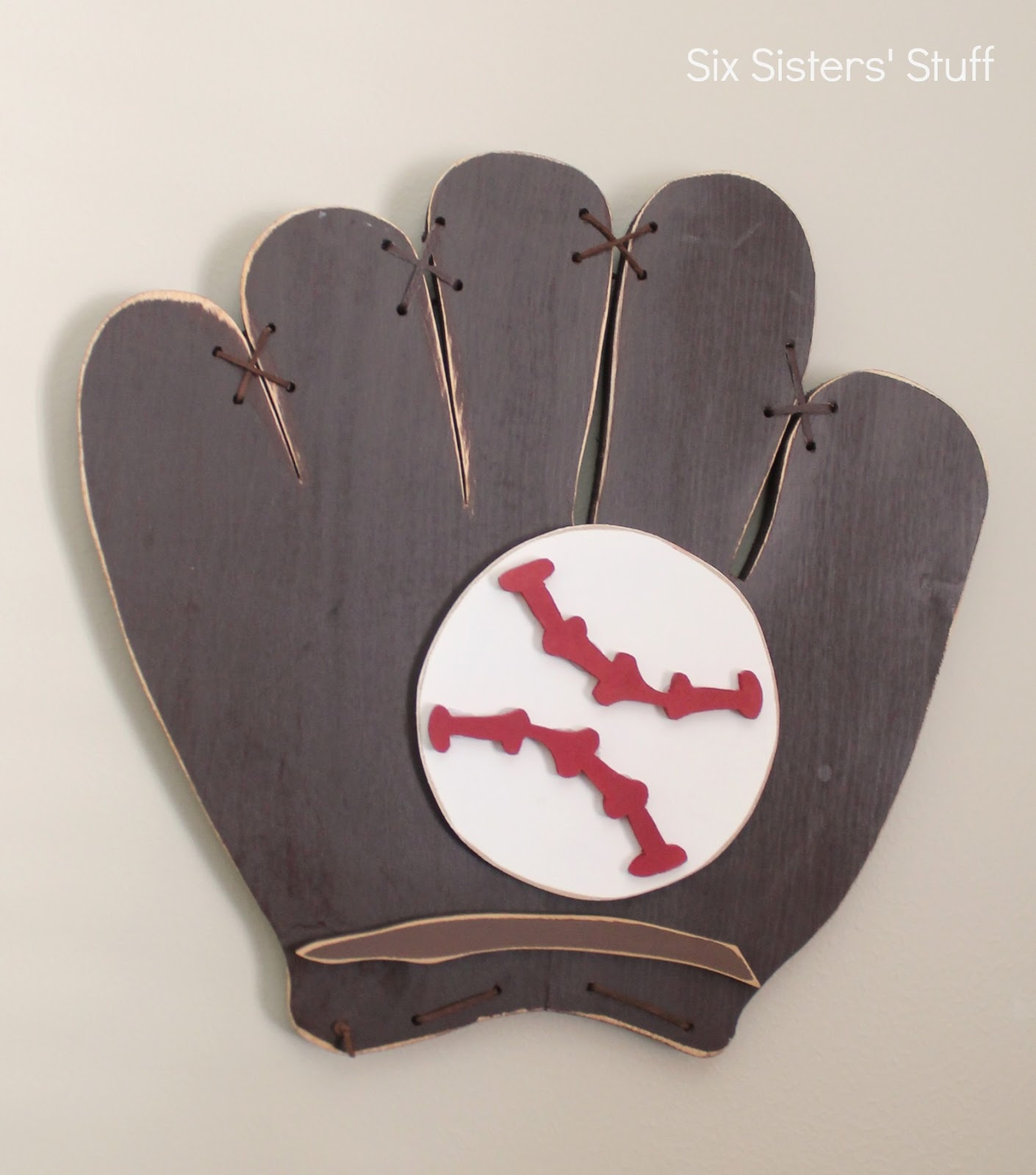 Cute I bought this wood baseball mitt decoration from Wood Creations a few years ago and decided to hang it up