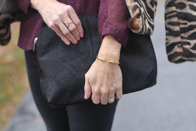 calf hair clutch, vita fede bracelet