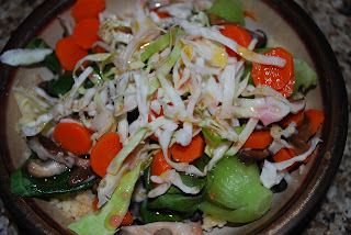 Millet and black beans, topped with steamed and raw veggies with a ume plum vinaigrette