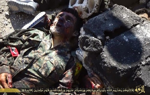 Video photos isis beheads syrian soldiers puts heads on poles in