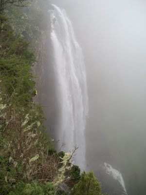 A picture of the falls first and second stages, shrouded in mist.