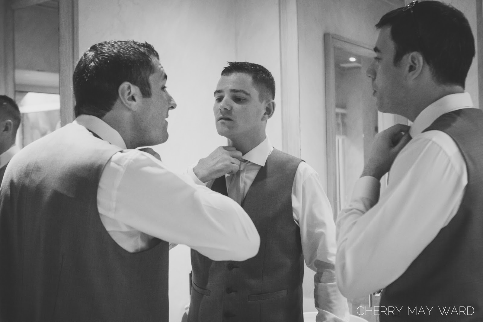 groom and his friends getting ready, tying ties, Koh Samui wedding photographer, Cherry May Ward photography