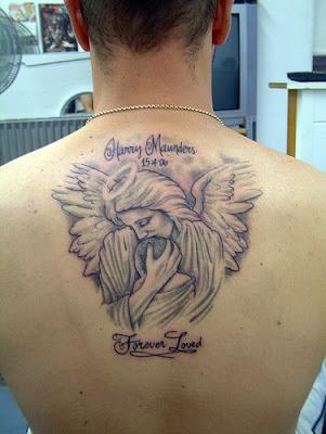 Cute Angel Tattoos,tattoo designs,angel tattoos,tattoos pics,tattoos pictures,pic of tattoos,tattoos designs,angel pictures,tattoo design,tattoo art,angel pics,free tattoos