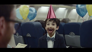 A screenshot of Facebook's new TV commercial, set on an airplane