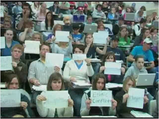 students in a classroom holding messages from The Vision of Students Today