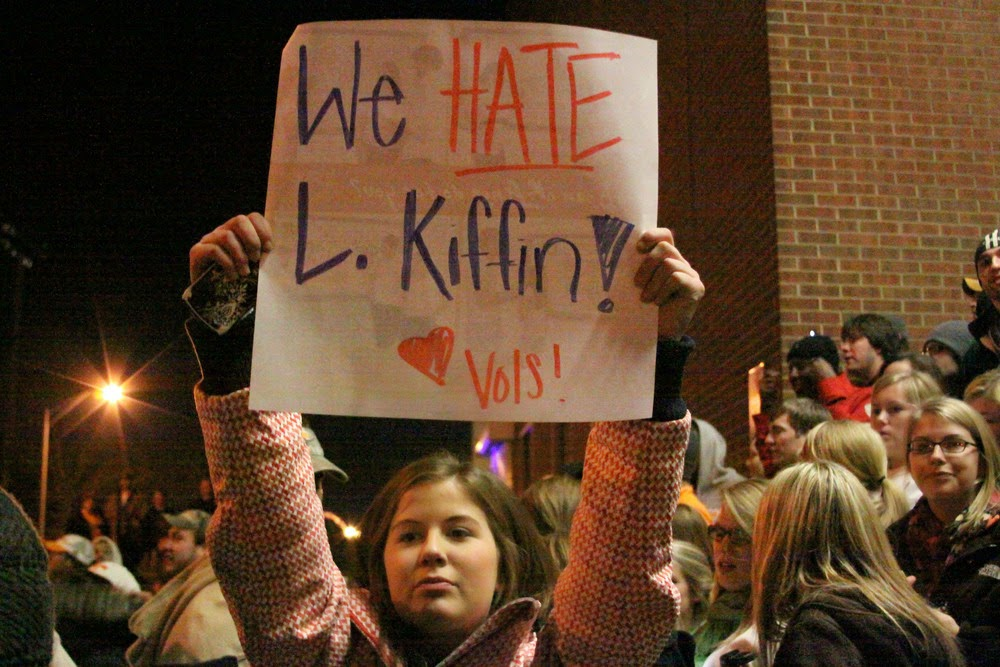"A Tennessee fans up a ""We Hate Lane Kiffin"" sign"
