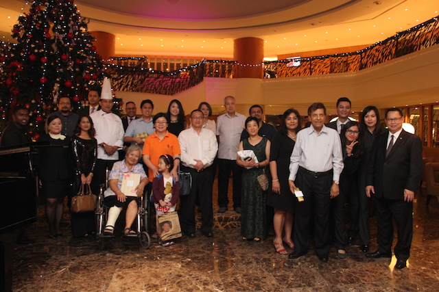 : At the end of the evening, the happy winners with key staff of the Sunway Putra Hotel