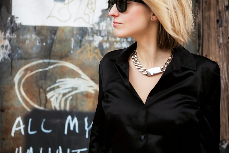 Rings & Tings silver chunky chain ID necklace, Joseph black satin button down, Ray-Ban Wayfarers, silver pearls