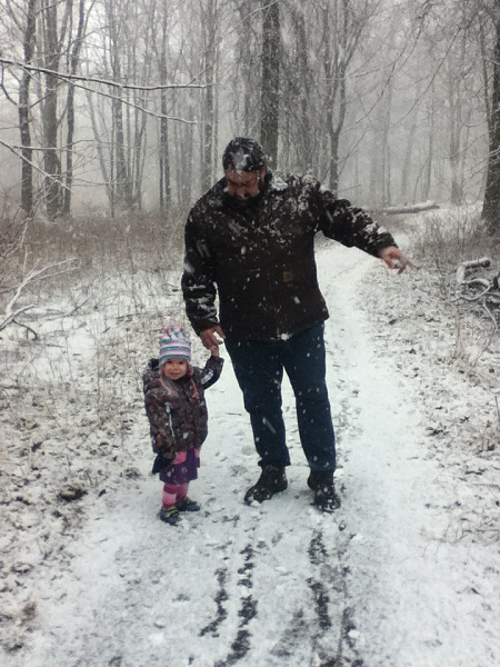 Daddy and Toddler hiking in the snow.