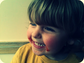 kid with ketchup on face