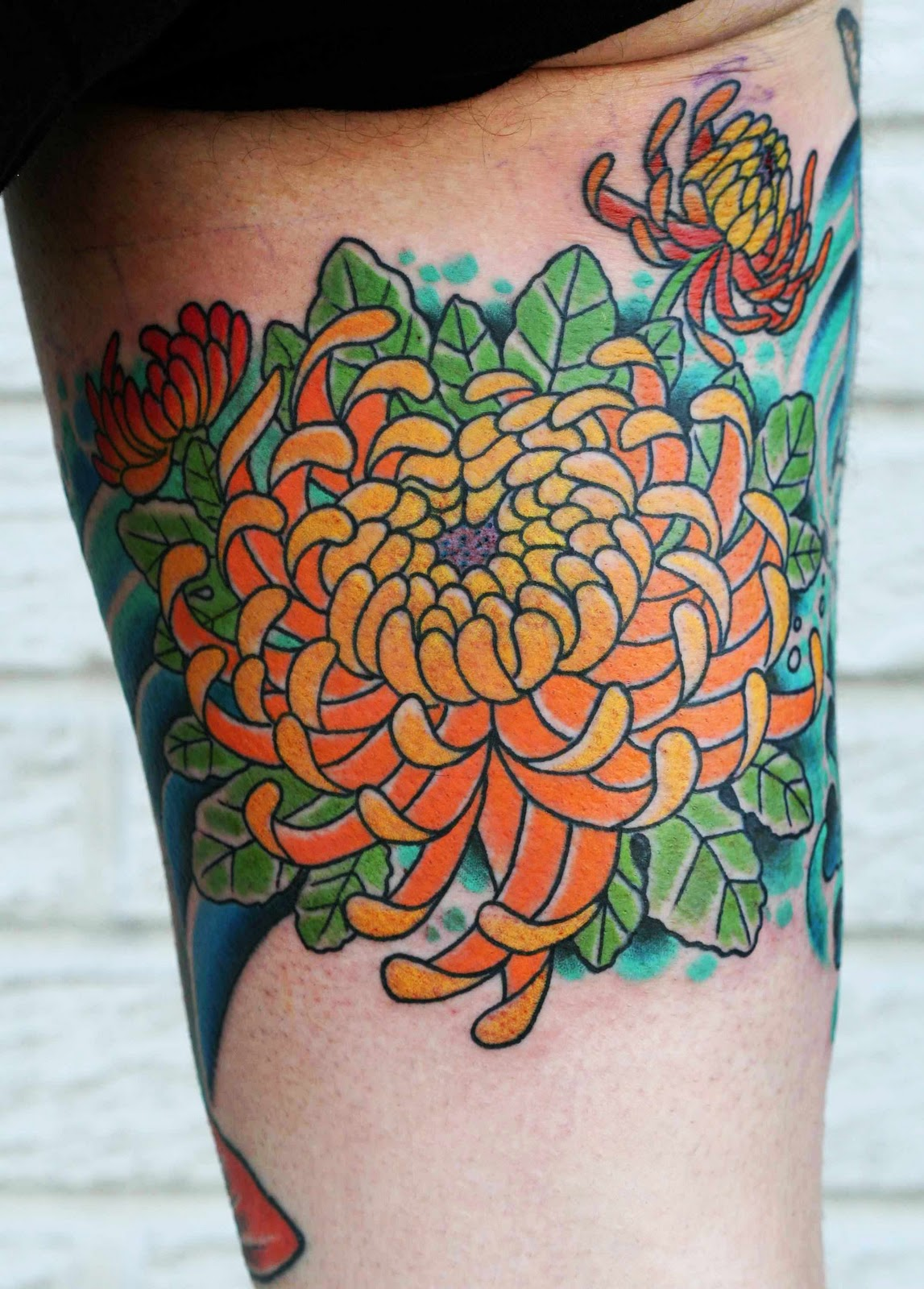 http://4.bp.blogspot.com/-Nq7SrY6FtUo/TvJ8CB1KJBI/AAAAAAAAABU/fw-6ykh4rtE/s1600/Chrysanthemum+Tattoo+Design+And+Symbols+on+arm.jpg