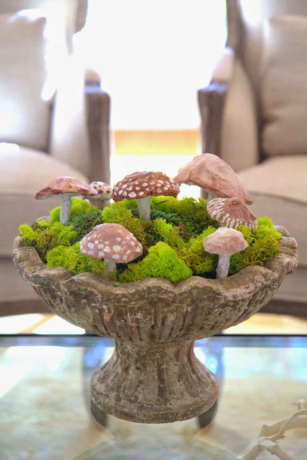 Woodland Party; Living Room coffee table, paper mache mushrooms and moss: Nora's Nest