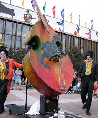 Clowns with cello in the children's area of the Montreal Jazzfest