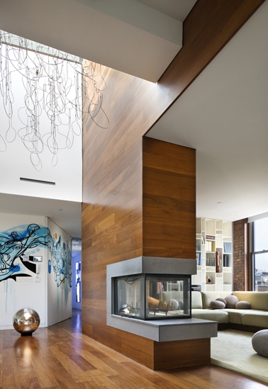 Photo of huge wooden fireplace in the penthouse