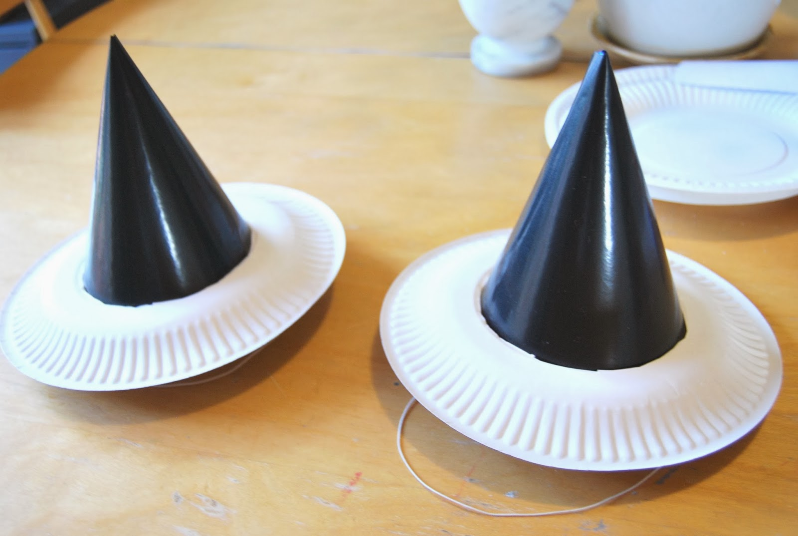 Slide the paper plates over the top of the party hats to see if the center hole is big enough before painting. You want the plate to sit low on the hat ... & A Little Learning For Two: Paper Plate Witches Hats