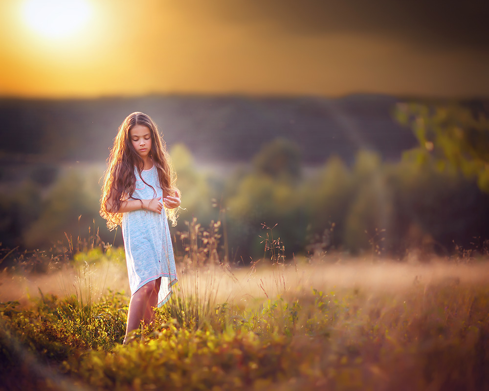 image of girl standing in the golden sun