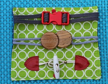 http://swoodsonsays.com/toddler-buckle-toy-tutorial-scrapbusting-saturday/