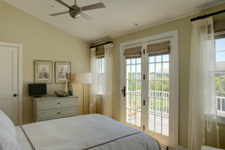 Coastal cottage style bedroom with sheers and beautiful views