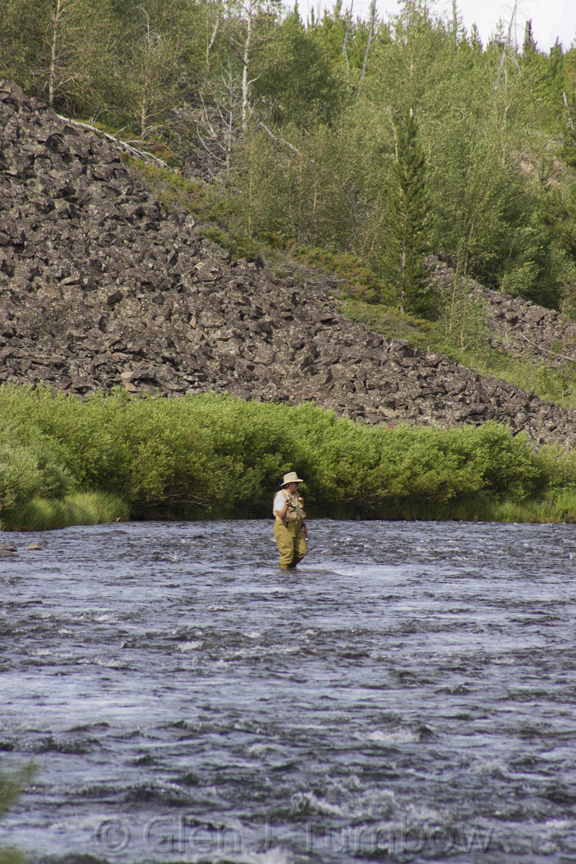 Fly Fisherman in the Gardner River at Sheepeater Cliff, Yellowstone National Park