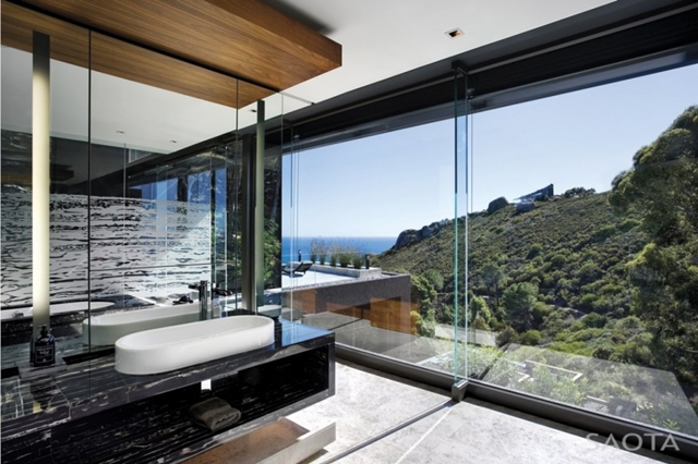 Picture of modern minimalist bathroom with the ocean and mountains view through the glass wall